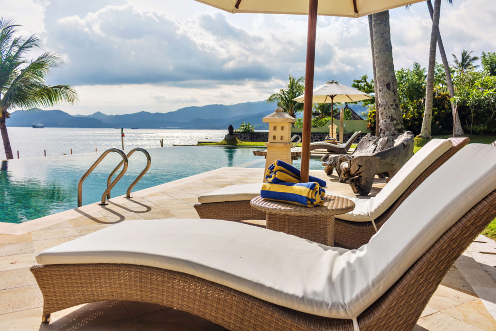 Oceanside pool and patio with mountain views at Citakara Sari Estate