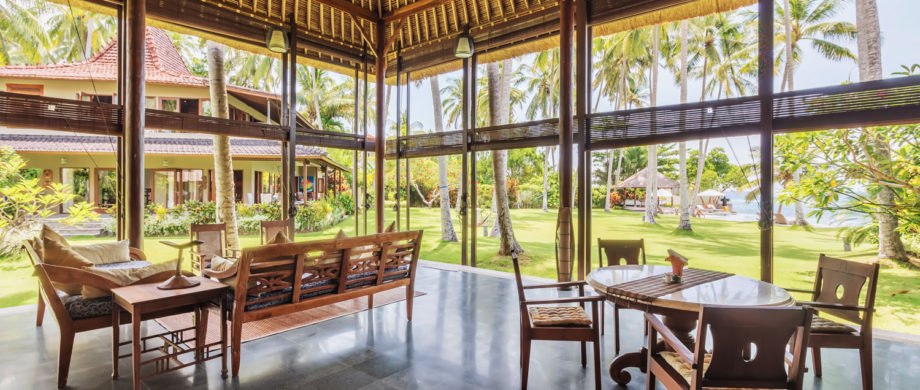 Beautiful view of manicured lawns and the ocean from Villa Yoga Bale at Citakara Sari Estate