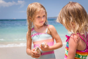 Kids finding sea shells at the private beach at Citakara Sari Estate in Bali